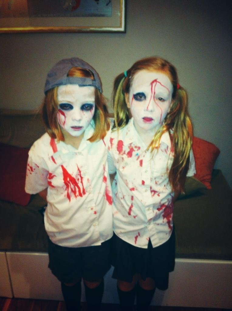 Two Trick-Or-Treaters prepare to hit town. Photo: Amanda B