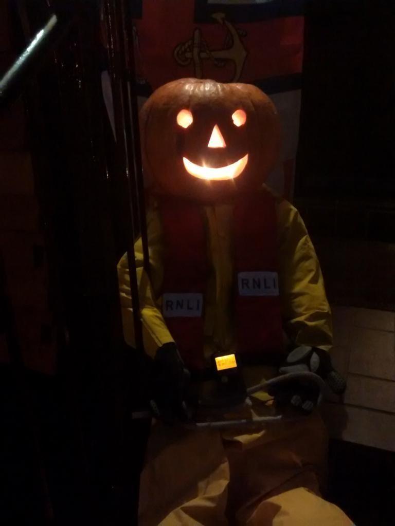 Rick O'Treat (crew no 13 at Teddington RNLI) practises his bowlines as he waits for a Halloween shout