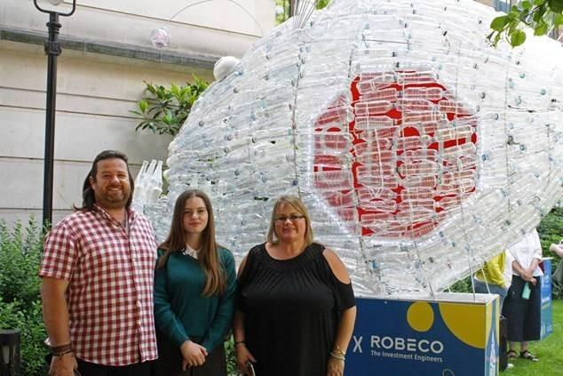 Kiera Jack and her parents standing in front of plastic sculpture